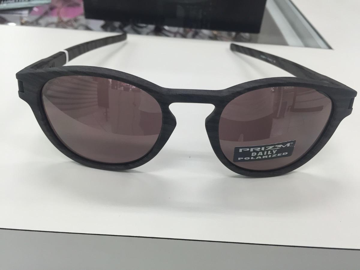 56577bbca4b59 oculos oakley latch woodgrain prizm polarized frete gratis. Carregando zoom.