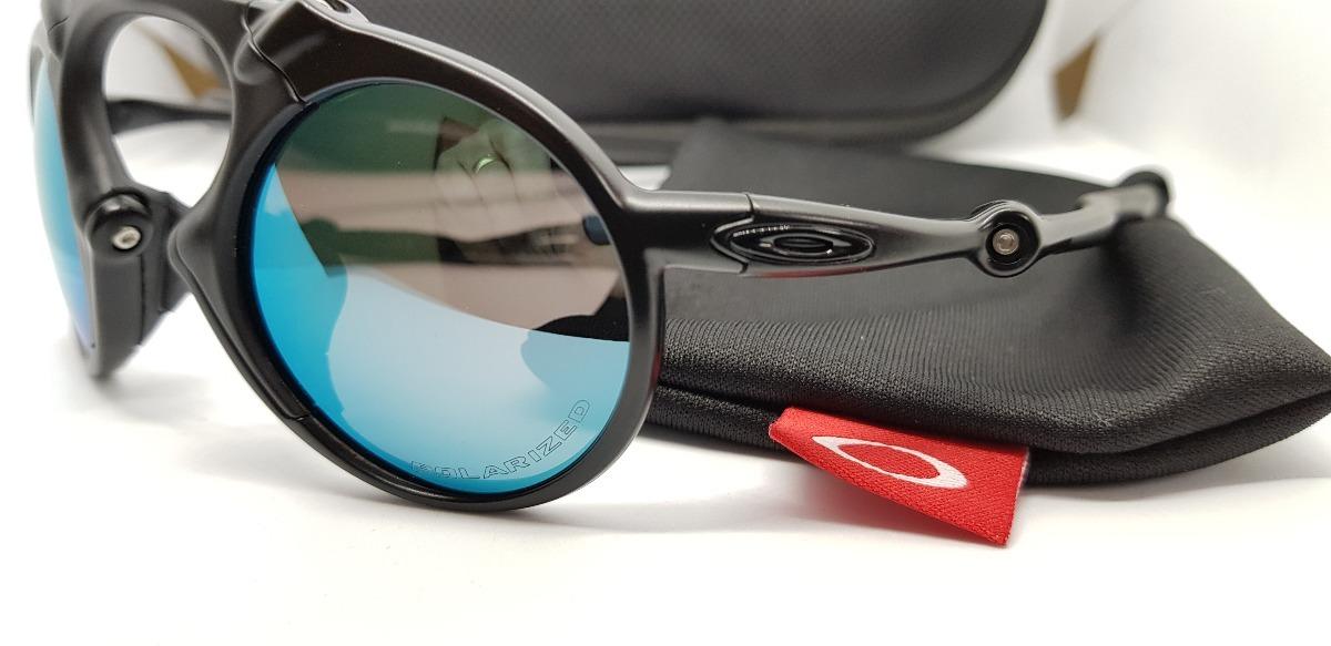 5d6109fc8291a óculos oakley madman black xmetal lente azul aço polarizada. Carregando zoom .