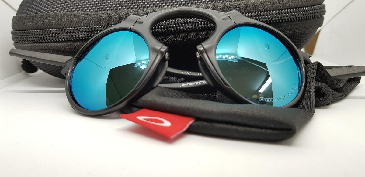 óculos oakley madman black xmetal lente azul aço polarizada. Carregando  zoom. 12c6c4318f