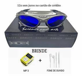6b5572bf7 Oculos Oakley De Sol Com Mp3 Que Levanta A Lente - Óculos De Sol no ...