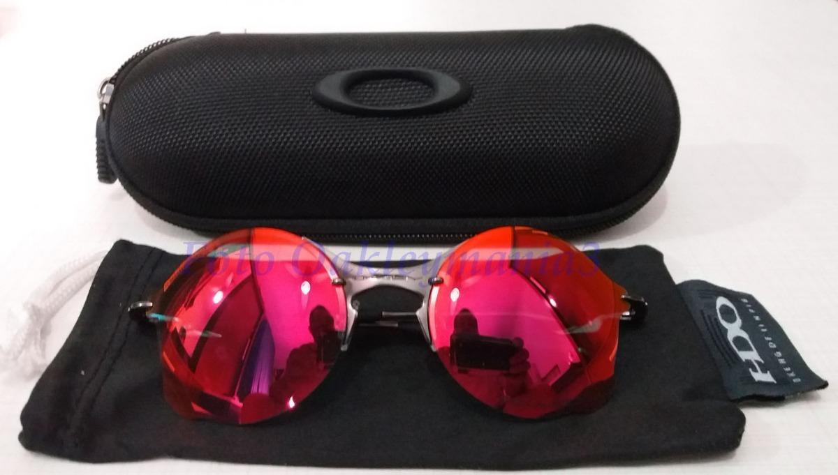 3faac2d56dabd oculos oakley tailend grafite lente fire ruby + case oakley. Carregando zoom .