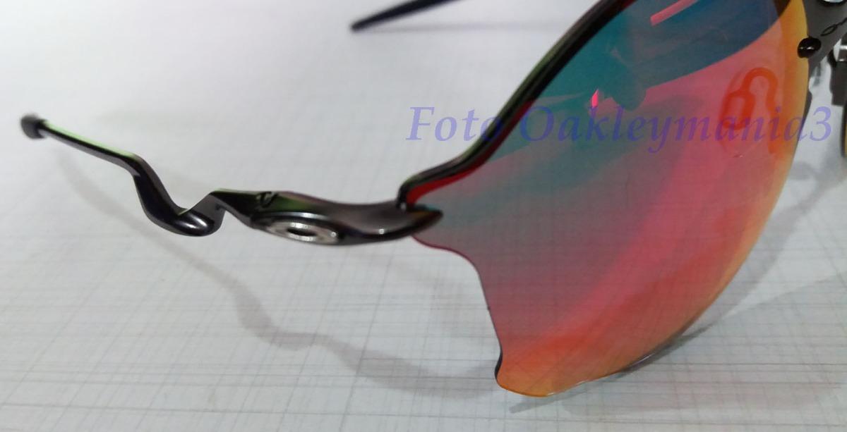 oculos oakley tailend grafite lente fire ruby + case oakley. Carregando  zoom. 5b26426396