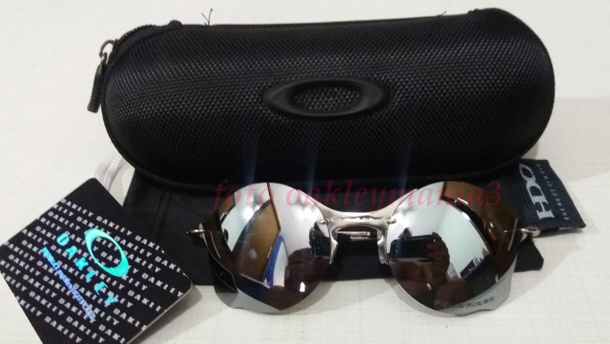 2ee0c60901553 oculos oakley tailend prata lente liquid metal + case oakley. Carregando  zoom.