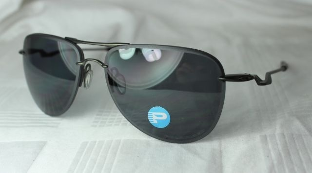 Oculos Oakley Tailpin Carbon Grey Polarized Frete Gratis - R  459,90 ... 3c4d1a61c9