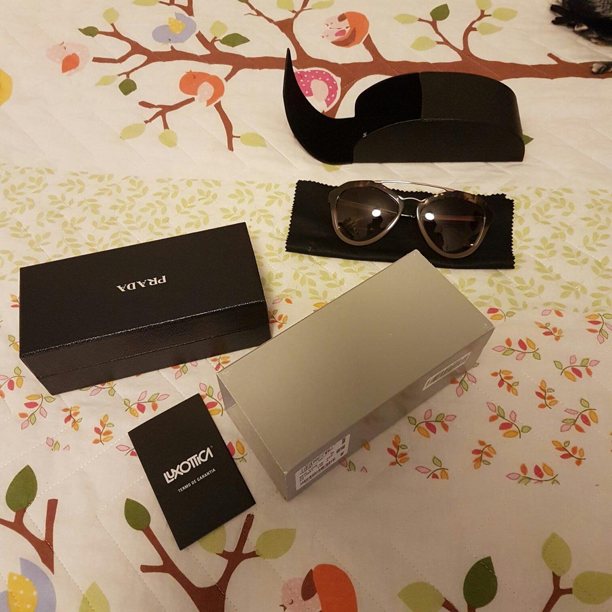 Óculos Prada Novo Na Caixa Com Nota Fiscal - R  780,00 em Mercado Livre 882fc39875