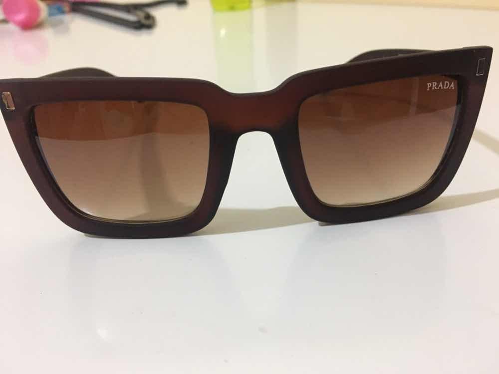 8189ece6cf378 Óculos Prada Original - R  100