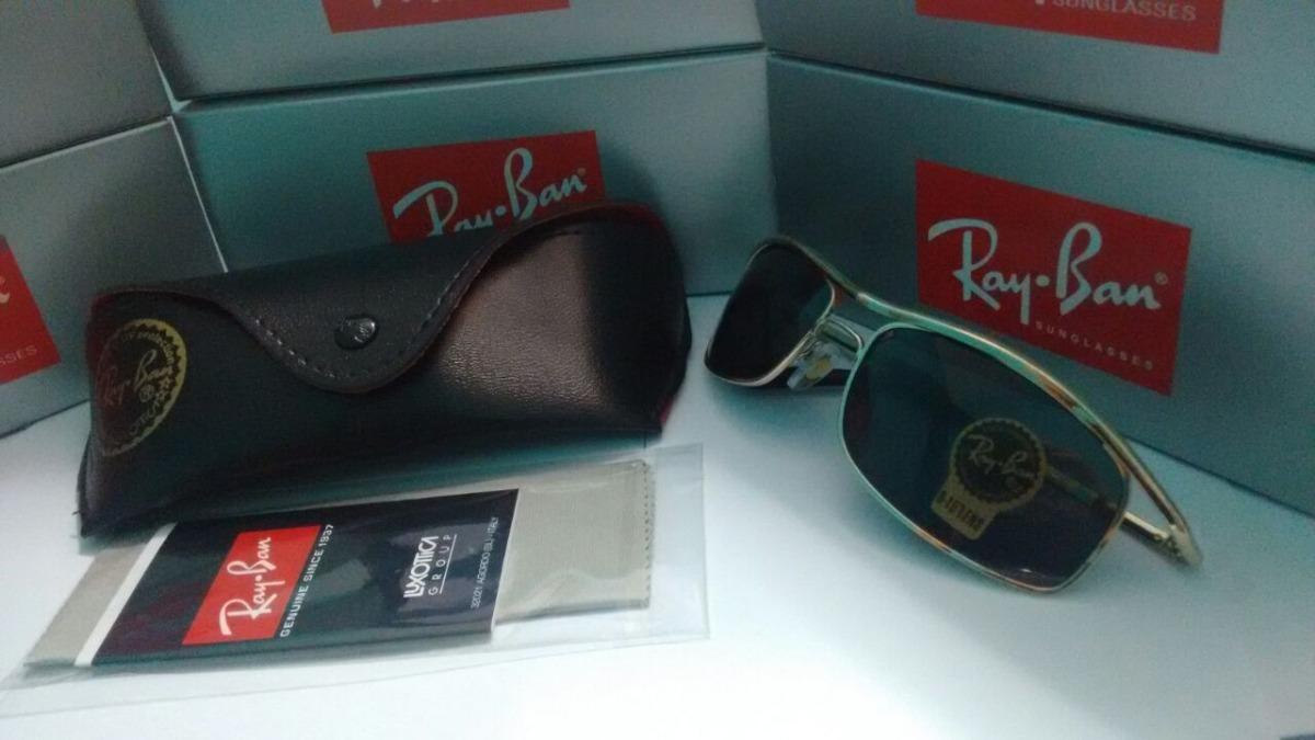 8e7938b926172 oculos ray ban 3339 demolidor dourado lente fumê. Carregando zoom.