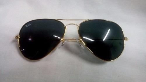 8ba4e1a5b239e Oculos Ray Ban Aviador Original Lentes Preta Armação Dourada - R ...