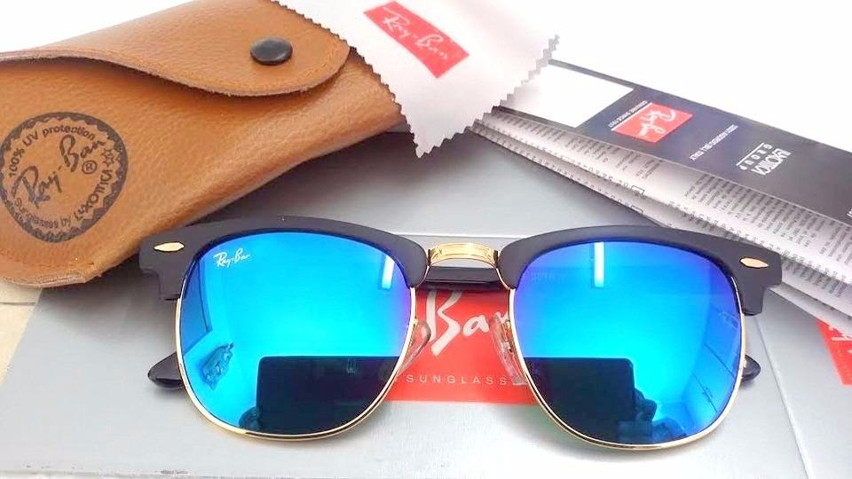 6710eb47e3e11 ... rayban clubmaster preto lente azul espelhada. Carregando zoom.