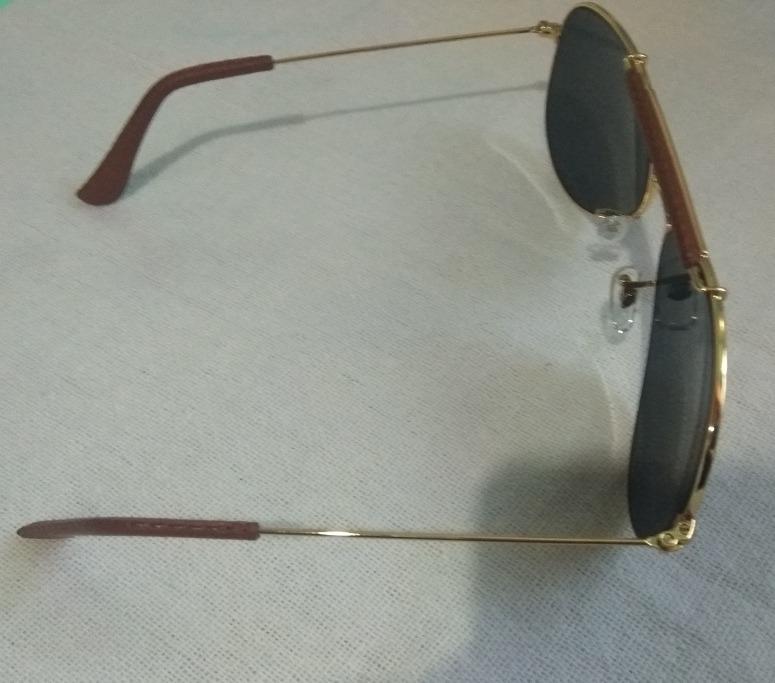 Oculos Rayban Caçador Armação Dourada Lente Preta+brinde - R  260,50 ... 8715daf3ab