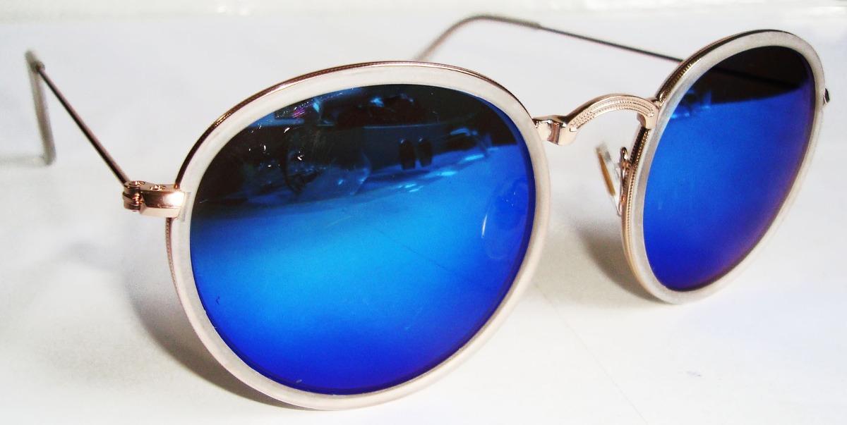 oculos redondo john lennon dourado lente azul espelhada. Carregando zoom. d3c81db89b