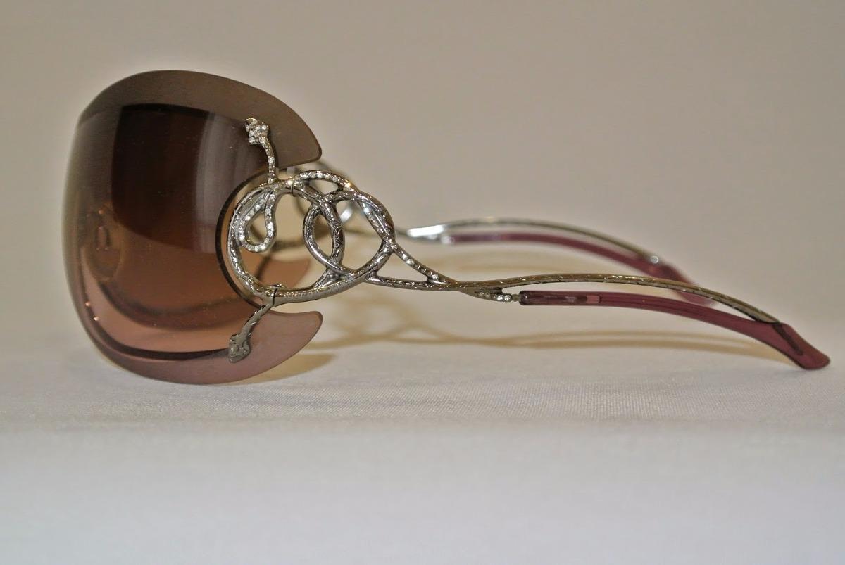 b556c4582 óculos roberto cavalli - modelo máscara - cor prata e lilás. Carregando  zoom.