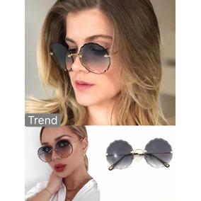 0c766483cc Óculos De Sol Trend Armações Sem Aro Redondo Chic