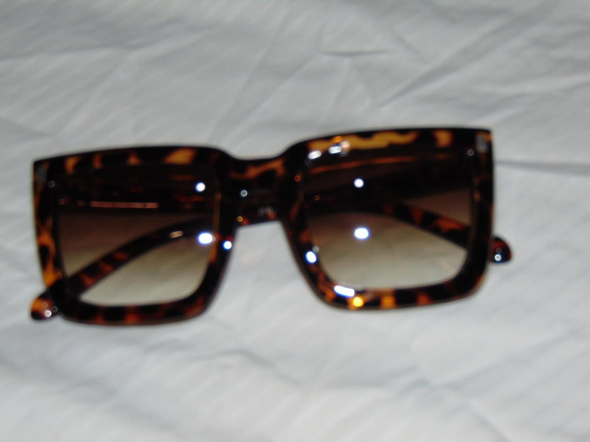 46b9cf47a06e3 Oculos De Sol Feminino Prada - R  250