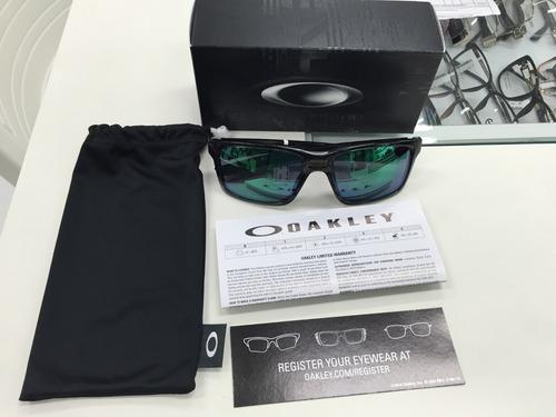254225bd10905 oculos solar oakley mainlink oo9264-04 original p. entrega. Carregando zoom.