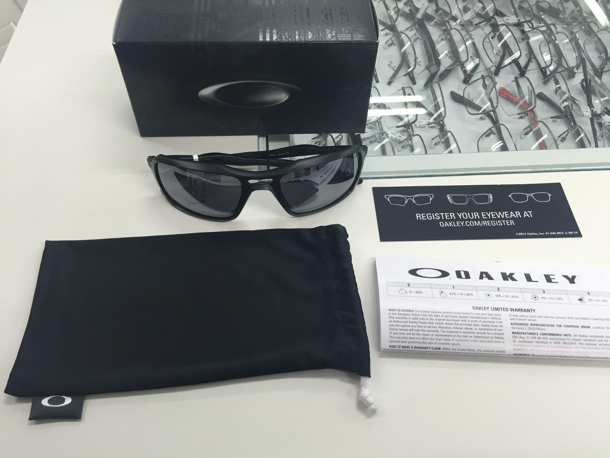 fb585087f7994 oculos solar oakley triggerman oo9266-01 original pronta ent. Carregando  zoom.