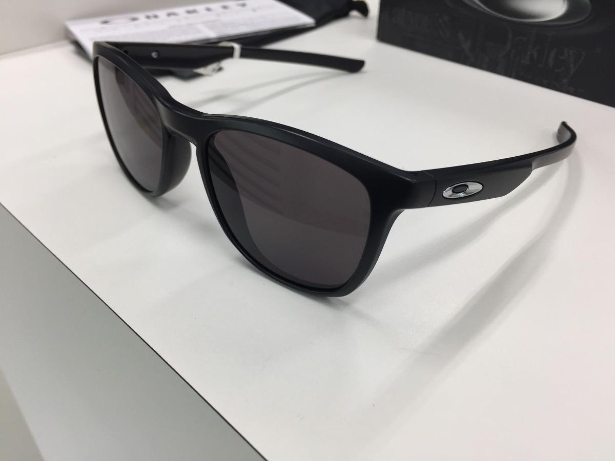 7bd49f90ed8d4 oculos solar oakley trillbe x oo9340 01 warm grey original. Carregando zoom.