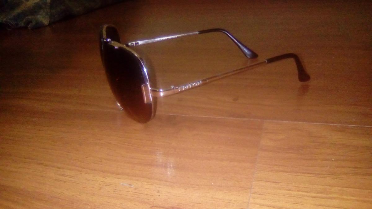 Oculos Triton Aviador Lentes Marrom E Armação Dourada - R  80,00 em ... dd1e81a5e9