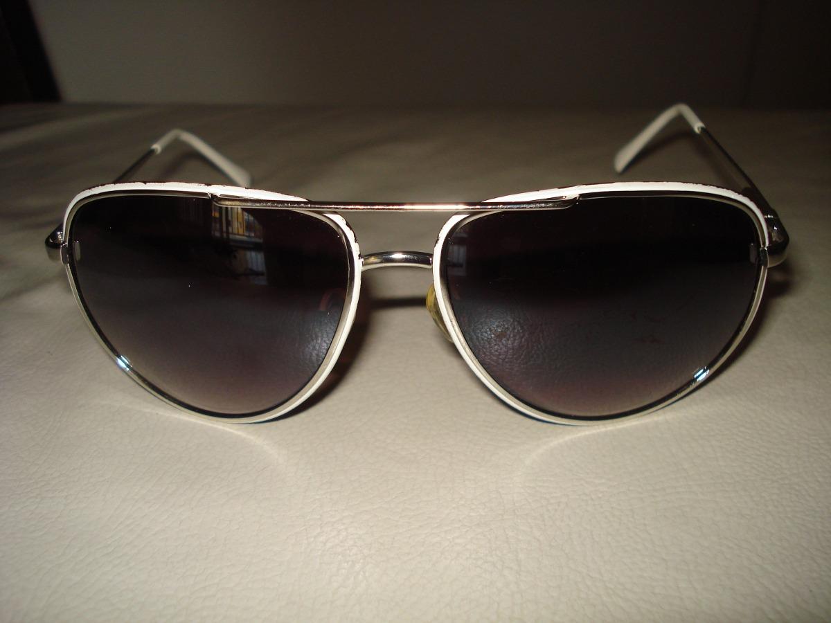 082103300 Óculos Triton Modelo Aviador Branco/ Cromado - R$ 103,50 em Mercado ...