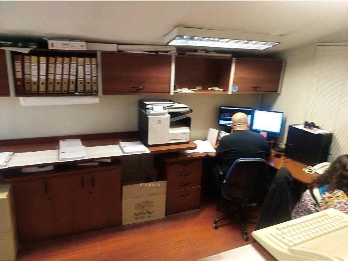 oficina de 13 privados en 2 pisos suecia / eliodoro yañez