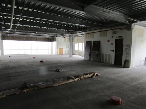 oficinas en obra gris en edificio corporativo