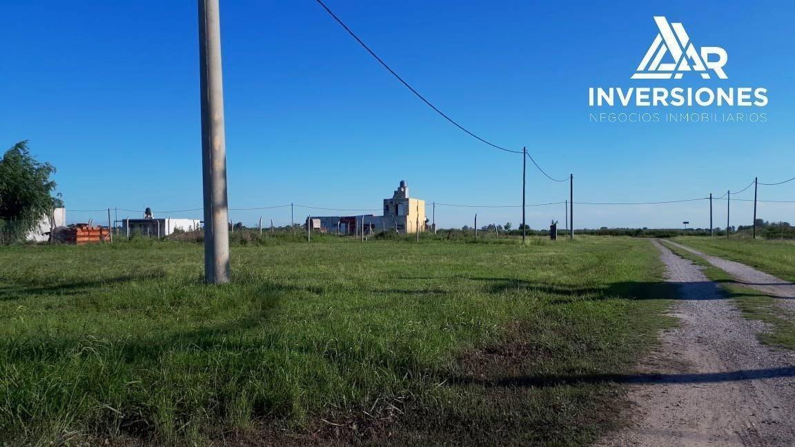oportunidad. terreno de 500 m2 en timbues. barrio abierto don ferruccio. oportunidad.