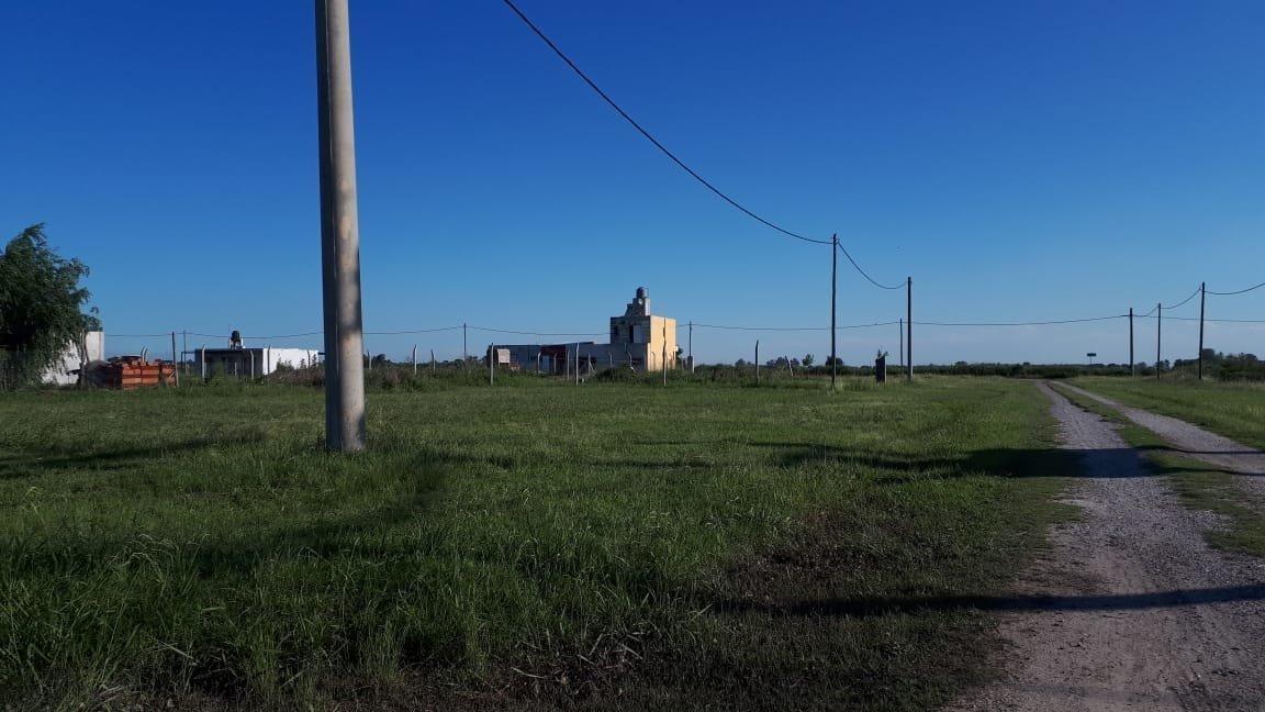 oportunidad. venta de lote en barrio abierto don ferruccio. timbues. lote de 500 m2.