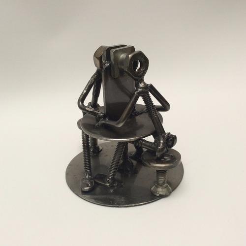optometrista / oftalmólogo / figura hecha de metal / fierro