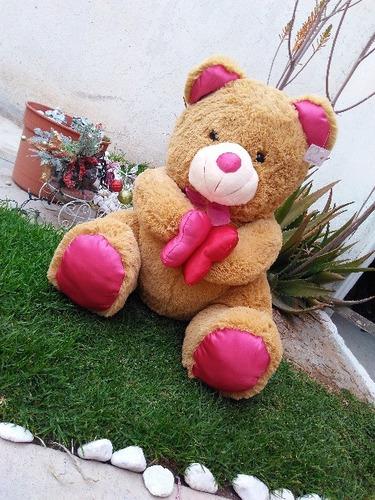 oso de peluche café grande con patas rosas 70 cms