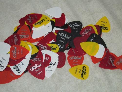 pack de uñetas guitarra 0.58 mm. colores a elección