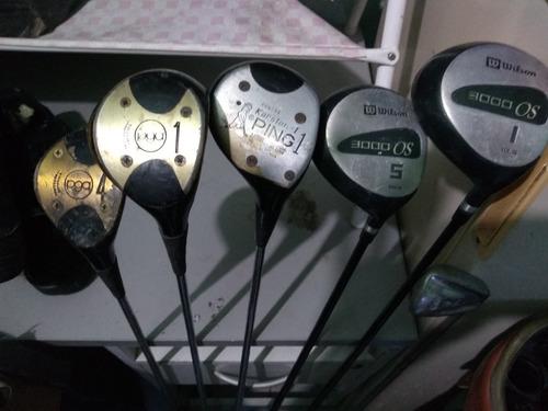 palos de golf con carrito de mano