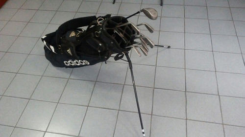 palos de golf y bolso adidas
