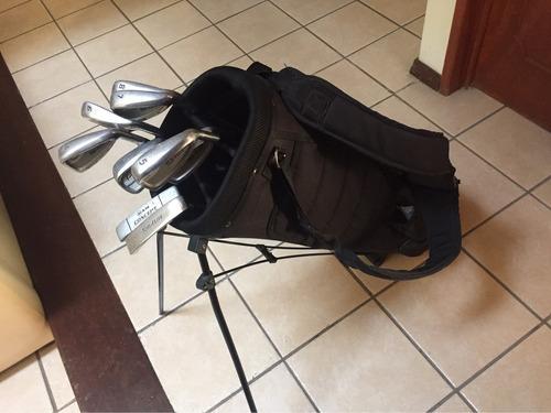palos de golf y maleta. top flite
