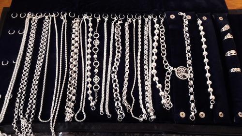 paño grande mas 25 pulseras o collares de acero blanco