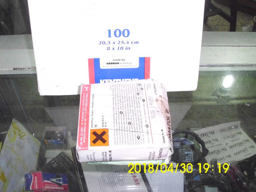 papel fotográfico de 100 unidades con su revelador y fijador