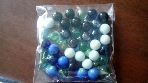 paquete x50 canicas diferentes diseños y  tamaños