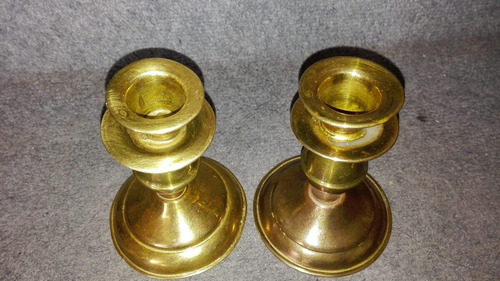 par de candelabros de bronce antiguos