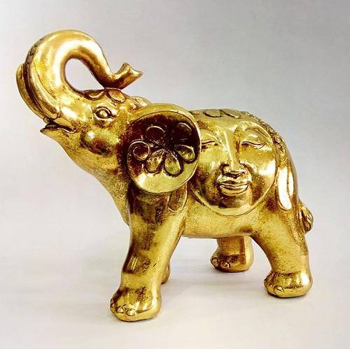 par de elefantes dorado y plateado con cara de buda