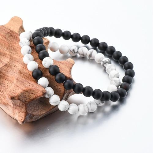 par de pulseira em pedras obsidiana e hawlita unisex