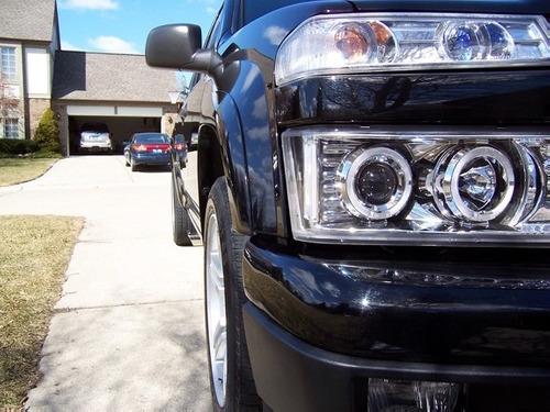 par faros cromados lupa led ojo angel gmc canyon 2004 - 2012