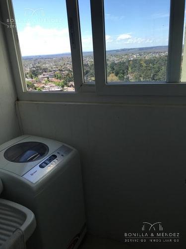 parquemar roosevelt, piso alto, 2 dormitorios, 2 baños, garage en sub suelo