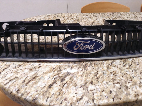 parrilla laser ford original 02 a 06