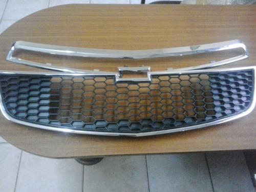 parrilla y rejilla central radiador (cruze)