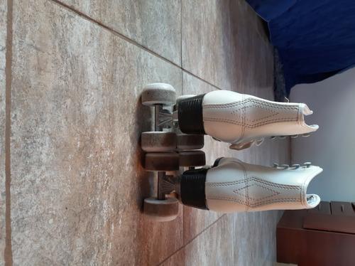 patines daiwa t.36 c/ cubre bota y estuche