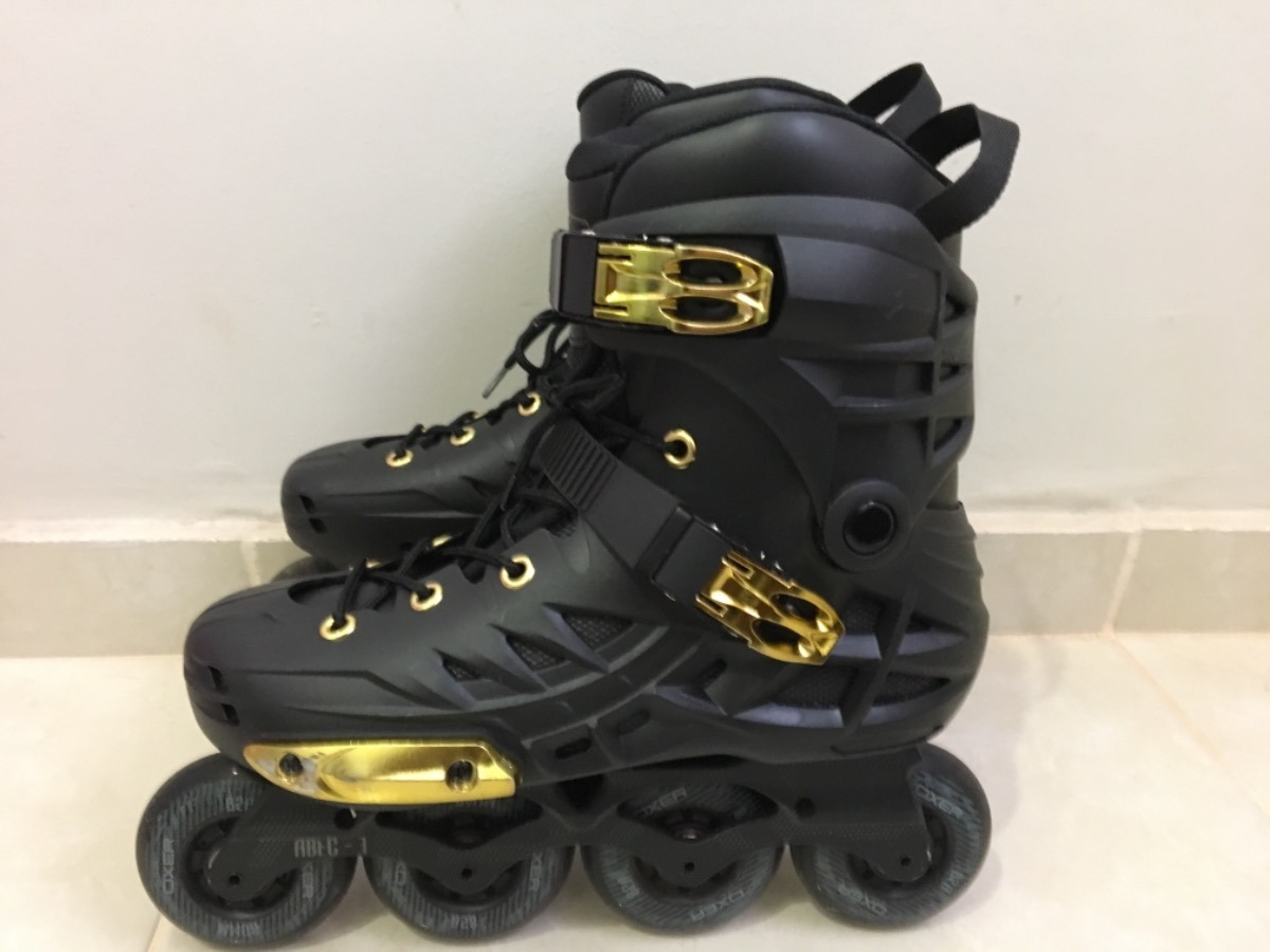 2ddc5edc076 patins oxer darkness gold - in line - freestyle - abec 7. Carregando zoom.