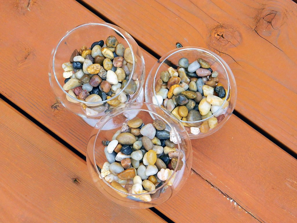 Piedras decorativas para centro de mesa aluzza for Mesa de jardin de piedra