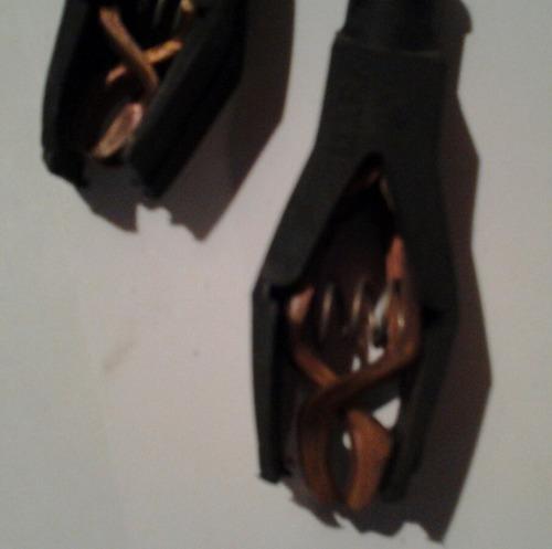 pinza caiman protegida para electricidad, electroauto.