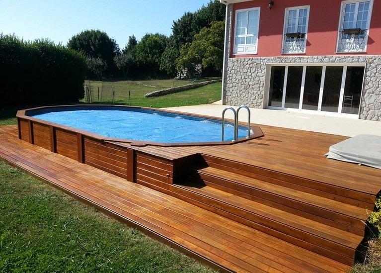 Piscinas revestidas em madeira pergolados reas de lazer for Modelos de piscinas con jacuzzi