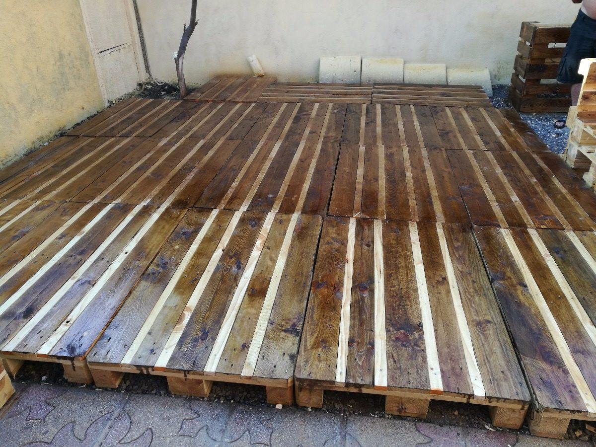 Piso terraza palets acabado en barniz en - Como hacer sillon de palets ...