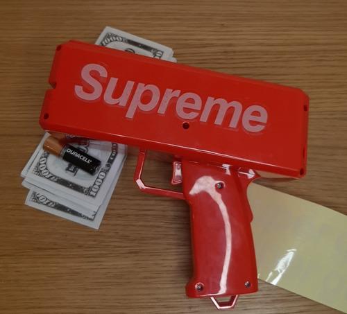 pistola lanza dinero (supreme)